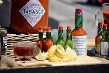 Free Assorted Hot Sauce Bottles Stock Photography - 117852892