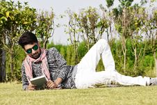 Free Man In White Pants Wearing Sunglasses Reading Book Stock Image - 117852991