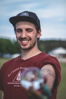 Free Smiling Man Wearing Maroon Shirt And Black Cap Royalty Free Stock Photo - 117917335