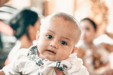 Free Baby In White Top In Tilt Shift Lens Shot Royalty Free Stock Photos - 117917378