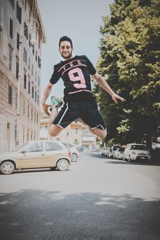 Free Photo Of A Guy Jumping On Road Stock Photography - 117988932