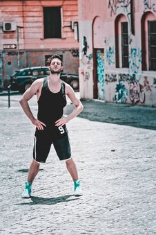 Free Man In Black Tank Top Posing At The Road Stock Photography - 117988962