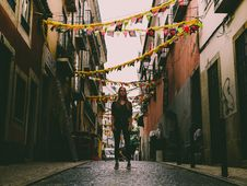 Free Woman Standing In Middle Of Street With Bantings Royalty Free Stock Photos - 117988988
