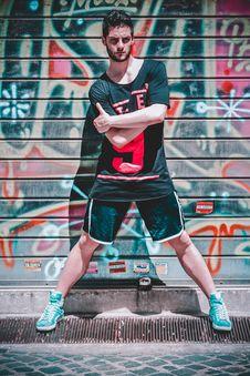 Free Man Wearing Black Black T-shirt And Black Gym Shorts Stock Images - 117988994