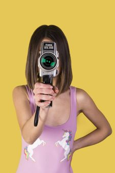 Free Girl Wearing Purple Tank Top Holding Canon Camera Stock Images - 117989054