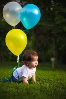 Free Baby Wearing White Shirt Tied With Three Balloons Stock Image - 117989091