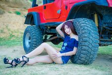 Free Woman Wearing Blue Off-shoulder Blouse And Blue Denim Short Shorts Sitting Near Red Truck Royalty Free Stock Photo - 117989095