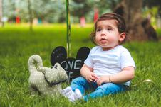 Free Depth Of Field Photography Of Baby Sitting On Green Grass Stock Photography - 117989132