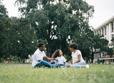 Free Family Sitting On Grass Near Building Royalty Free Stock Photo - 117989135