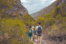 Free Two Men And Woman Walking Surrounded By Mountain And Trees Royalty Free Stock Photos - 117989168