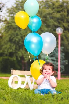 Free Girl Wearing White Shirt Near Teal, White, And Yellow Ballons Stock Photo - 117989250