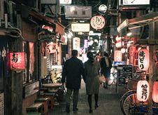 Free Couple Walking On Street At Night Royalty Free Stock Photo - 117989255