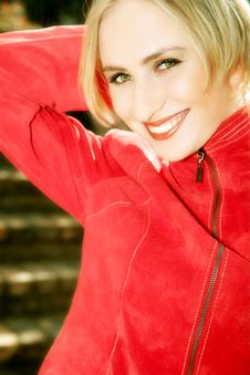 Happy Blond In Red Royalty Free Stock Photography