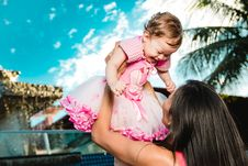 Free Woman Holding Baby Above Head Stock Photography - 118112182