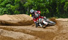Free Person Driving Dirt Motorcycle On Sandy Stadium Stock Images - 118221484