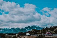 Free Vehicles Passing By Mountain Royalty Free Stock Photography - 118221567