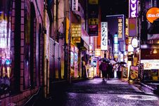 Free Woman Walking In The Street During Night Time Stock Images - 118221654