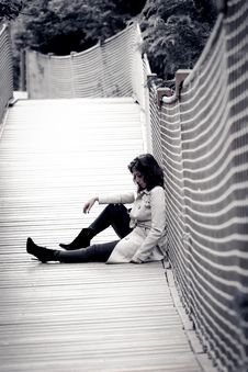 Free Low Light Photo Of Woman Wearing Trench Coat Sitting Against Wall Stock Image - 118221671