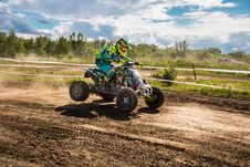 Free Person Riding Atv Under Sunny Sky Stock Photography - 118221732