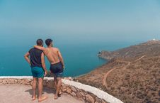 Free Two Man Standing On Mountain Cliff With Ocean View Stock Photo - 118221810