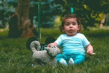 Free Toddler Wearing Teal T-shirt And Teal Pants Beside Gray Cat Plush Toy Stock Photo - 118290500