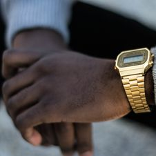 Free Person Wearing Gold-colored Casio Digital Watch With Linked Strap Stock Images - 118290564