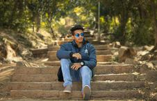 Free Man Wearing Blue Jacket Sitting Stairs Stock Images - 118290624