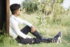 Free Man In White Long-sleeved Top Sitting On Green Grass Royalty Free Stock Image - 118290626