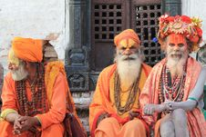 Free Three Men Wearing Orange Tradition Clothes Royalty Free Stock Photography - 118290627