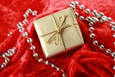 Small Golden Festive Box On Red Velvet Background Stock Photo
