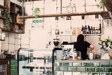 Free Woman Wearing Black Shirt In A Coffee Shop Stock Image - 118386161