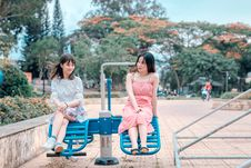 Free Two Women Sitting In Blue Park Ride Stock Images - 118386224