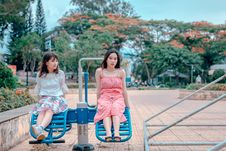 Free Two Woman Sitting At Park Ride Royalty Free Stock Photo - 118386235