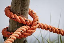 Free Orange Rope Wrapped Brown Wood Log Stock Photo - 118386260