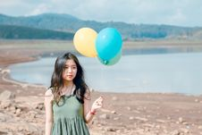 Free Shallow Focus Photography Of Woman Holding Three Assorted-color Balloons Royalty Free Stock Photos - 118386298