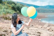 Free Woman In White And Black Dress Holding Three Balloons Stock Images - 118386384