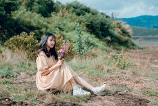 Free Woman With Beige Dress And White Shoes Sitting On Green Grass Stock Images - 118386394