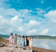 Free Group Of Women Wearing Dress Standing Near Body Of Water Stock Photo - 118464630