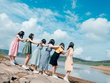 Free Six Women Standing Near Body Of Water Royalty Free Stock Images - 118464649