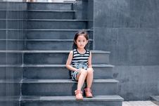 Free Girl Wearing Black And White Striped Dress Sitting On Stair Stock Photography - 118464682