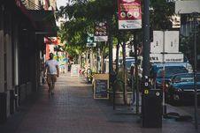 Free Man Wearing White Crew-neck T-shirt Walking On Sidewalk Royalty Free Stock Image - 118464766