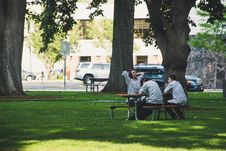 Free Photo Of Men Sitting On Picnic Bench Royalty Free Stock Photos - 118464778