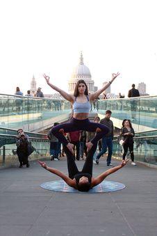 Free Two Women Performing Yoga On Street At Daytime Royalty Free Stock Photos - 118545948