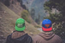 Free Shallow Focus Photography Of Two Men Wearing Caps Royalty Free Stock Photo - 118545975