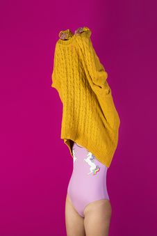 Free Photo Of Woman About To Wear Off Yellow Sweater In Pink Background Stock Photos - 118546153