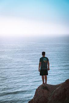Free Man Standing On Cliff Near Sea Royalty Free Stock Photos - 118598738