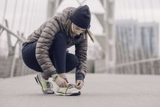 Free Photo Of Woman Tying Her Shoe Royalty Free Stock Photo - 118598915
