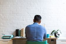 Free Man Sitting On Chair Facing Table Stock Image - 118598921