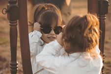 Free Girl In White Long-sleeved Shirt Wearing Sunglasses Facing Mirror Stock Photo - 118920640