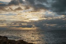 Free Sea Under Gray Cloudy Sky During Dawn Royalty Free Stock Photos - 118920688